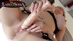 Mature blonde Lady Sonia uses a vibrator on her clit