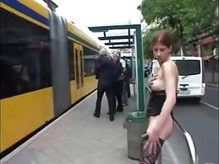Tram breast reconstruction - Bare-breasted girl pisses at a tram stop