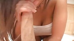 Hot brunette with big tits gives a great handjob