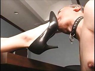 Redhead secretaries - Redhead boss makes him suck her feet