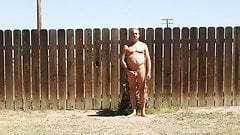A daddy parading around naked in his backyard.