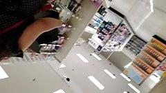 Brunette woman upskirt while shopping