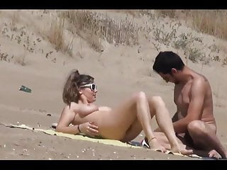 Women undressing nude Couple split by strangers on a nude beach