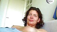 Brunette mature masturbates