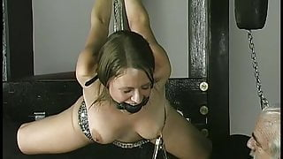 Old fat guy binds and suspends cute brunette with small tits in dungeon