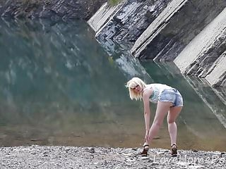 Tear near the clitoris - Busty blonde displays her figure near the lake
