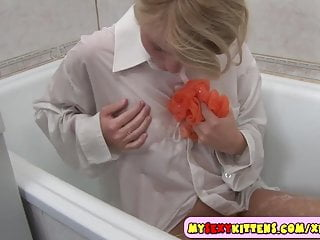 Vintage baby bath tub Young blondie in a bath tub