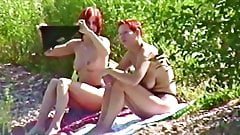 Renate and Peggy Topless by the Lacke
