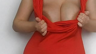 Tit play in red dress
