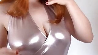 Sexy Redhed in Siver Swimsuit Dancing