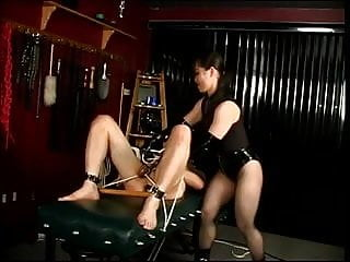 Naked punished duded in leather - Mistress in leather and heels punishing slave boy