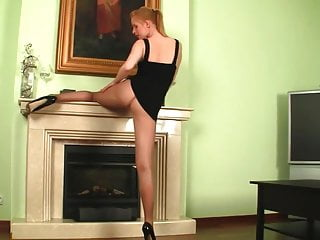 Sex by a fireplace Pantyhose redhead seduces a fireplace