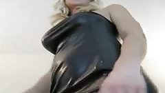 Blonde girl in tight leather dress