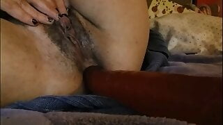 masturbating with a dildo in the ass