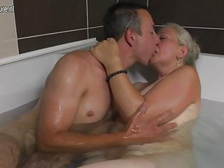 Mature bathing - Dirty granny takes young cock in bath