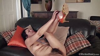 Hairy mature Tracey Anne strokes her hairy body and pussy