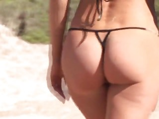 Alicia in micro bikini Hot brunette milf in micro bikini posing on public beach 3