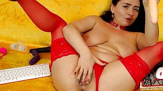 Mature woman caresses her hole