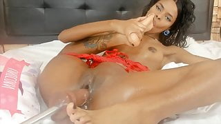 Slut ebony with bald pussy squirting with fuck machine