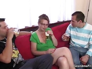 Two old ladies sucking their tits Busty mom enjoys sucking and riding two cocks