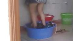 The cleaner is washing the clothes