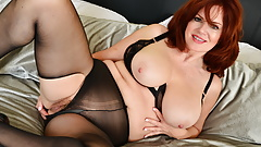 Redhead milf Andi James pleasures her mature pussy