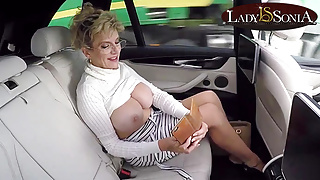 Mature Lady Sonia exposes her big tits in the car