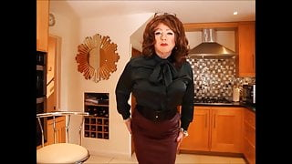 Sindy in green satin blouse and leather burgundy skirt