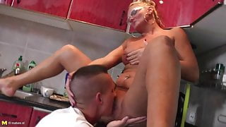 STEP MOM takes young cock in the kitchen