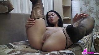 Gorgeous dark haired babe masturbates
