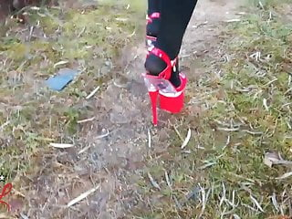 Anal lady boy high heels tube Lady l walking metal road with sexy red high heels