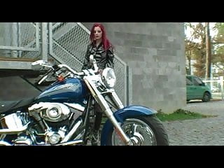 Gothic redhead teens Red-haired biker in exciting striptease
