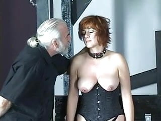 Spank this porn plays Cute brunette in corset is restrained by master before hard spanking play