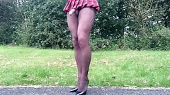 Black pantyhose schoolgirl outdoors in public .