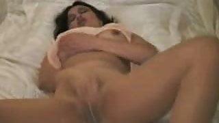 A beautiful mature masturbating in pantyhose