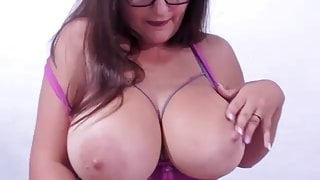 Krista teases with her big boobs and licks nipple