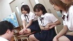 Four Japanese school girls spitting on teacher