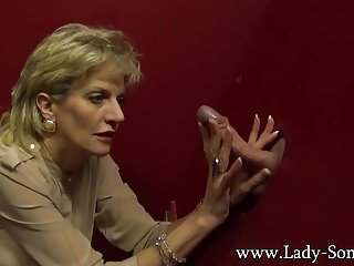 Gloryhole busty movies - Busty milf lady sonia milking a huge dick on the gloryhole