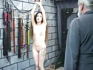 Wrist thumb support manufacturers Master takes rope around slaves wrists to lash her ass with leather whip