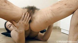 Gorgeous hairy brunette masturbates by her mirror