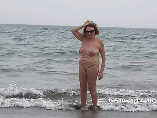 Suspended naked in nature Mature walking naked in public on the beach