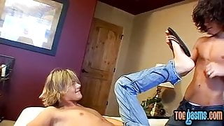 Skinny homosexual gives a footjob and takes it in the ass