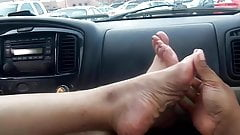 Sexy mature feet in car...