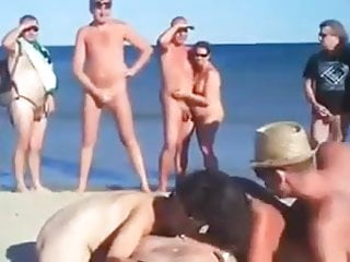 Hirsute women nudist Two women suck a man on a nudist beach