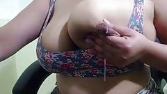 Busty Indian housewife milking her tits on cam