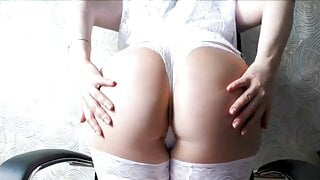A beauty in sexy lingerie fingers her wet pussy.