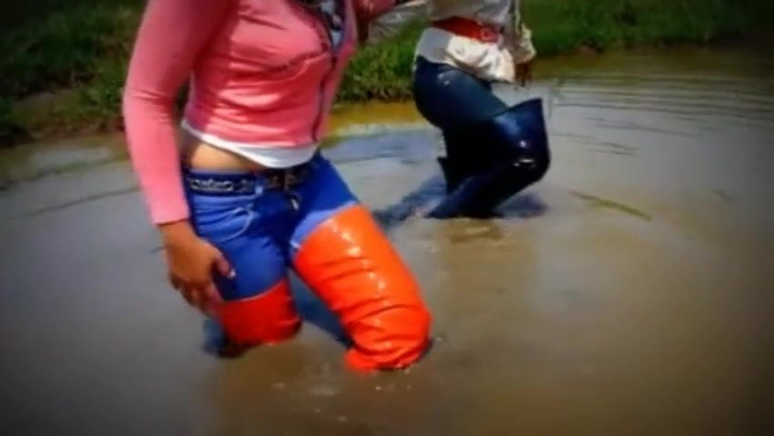 Two thai girls in muddy thigh boots!!!