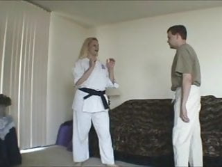 How to reduce female breast - Female black belt demos how to break his balls