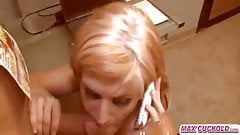 Busty milf sucks cock while on phone with husband