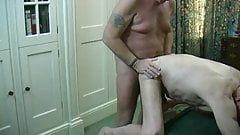 Two older men making love